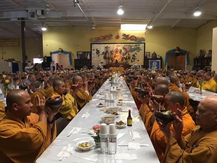 Buddhist engaged in mindful consumption of meal