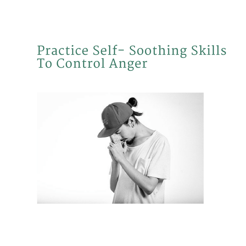 Young man with head bowed practicing self-soothing